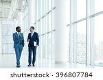 smiling businessmen in office   Shutterstock . vector #396807784