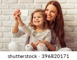 beautiful young mother is... | Shutterstock . vector #396820171