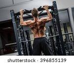 muscular man training his back... | Shutterstock . vector #396855139