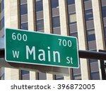 main street sign in front of... | Shutterstock . vector #396872005