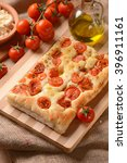 flat bread with cherry tomatoes ... | Shutterstock . vector #396911161
