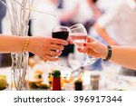 female hands with two wine... | Shutterstock . vector #396917344