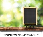 Blank Blackboard On Wood Table...