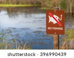 No Fishing Sign In Front Of A...