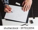 man draws a sketch on the table ... | Shutterstock . vector #397012054