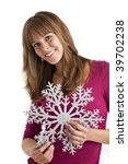 young woman holding a decorative snow flake - stock photo