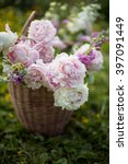 basket with summer flowers on... | Shutterstock . vector #397091449