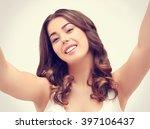 selfie.girl holding camera with ... | Shutterstock . vector #397106437