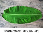 banana leaf on the table wood | Shutterstock . vector #397132234