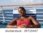 Lady relaxing on cruise ship - stock photo