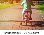 little boy riding bike in... | Shutterstock . vector #397185895