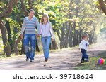 happy family walking in park | Shutterstock . vector #39718624