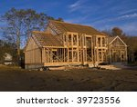 A new home under construction showing the all wood framing process. - stock photo