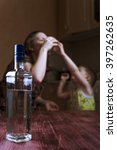 Small photo of Child asks mother stop drinking. Alcohol abuse, alcoholic addiction. Focus on bottle.