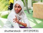 an african muslim woman is...   Shutterstock . vector #397293931