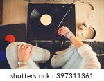 woman listening vinyl at home | Shutterstock . vector #397311361