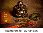 statue of happy buddha, symbols of chine astrology, oriental coins of good luck, yin yang symbol like a concept of oriental esoteric belief and  philosophy - stock photo