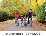 happy family in bike | Shutterstock . vector #39742078