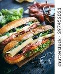 submarine sandwiches served on... | Shutterstock . vector #397453021