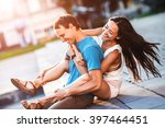 the boy rolls the girl on her... | Shutterstock . vector #397464451