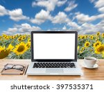 laptop computer and coffee on... | Shutterstock . vector #397535371