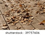 leaves on vintage outdoor porch | Shutterstock . vector #39757606