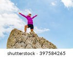 Small photo of Success achievement running or climbing accomplishment business concept, woman celebrating with arms up raised. Hands outstretched on hiking trip. Trail Running concept in inspirational landscape.