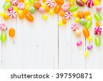 Variety Of Candies On A Wooden...