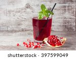 a glass of pomegranate juice... | Shutterstock . vector #397599049