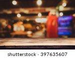 empty top of wooden table or... | Shutterstock . vector #397635607