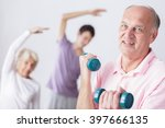 senior man holding dumbbells