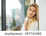 beautiful blonde woman sitting... | Shutterstock . vector #397731985