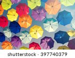 colorful umbrellas background.... | Shutterstock . vector #397740379
