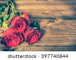 Red Roses Flowers On Wooden...