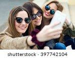 portrait of three young women...   Shutterstock . vector #397742104