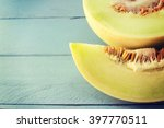 juicy honeydew melon on a... | Shutterstock . vector #397770511
