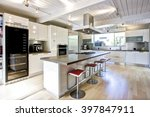 Stock photo modern white chef s kitchen with central island 397847911