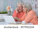 happy senior couple with laptop | Shutterstock . vector #397902334