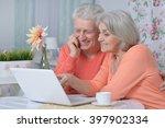 happy senior couple with laptop | Shutterstock . vector #397902334