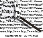 Magnifying glass searching many web pages - stock photo