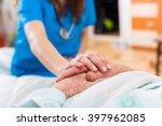 nurse holding the hand of an... | Shutterstock . vector #397962085