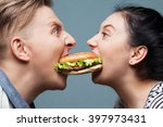 man and woman eating a burger | Shutterstock . vector #397973431
