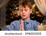 Child Praying Out Loud. Boy...