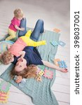 mom playing with their young... | Shutterstock . vector #398037001