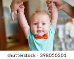mother teaching her cute little ... | Shutterstock . vector #398050201