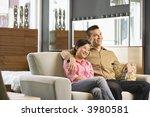 asian couple watching... | Shutterstock . vector #3980581