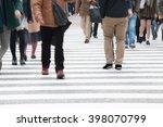 motion blurred  people across... | Shutterstock . vector #398070799