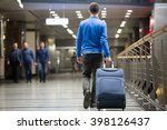 young man pulling suitcase in... | Shutterstock . vector #398126437