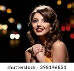 smiling glamor girl posing | Shutterstock . vector #398146831