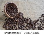 coffee beans spill out of a...